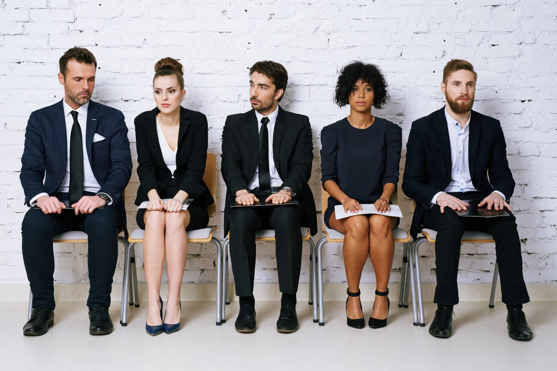 Group of people wait for their executive coaching